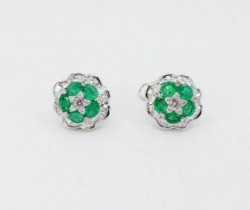 Emerald and diamond earrings in 18k white gold.