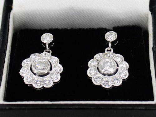 Diamond flower dangle earrings in platinum
