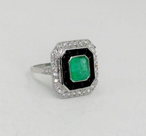 Large emerald, diamond black onyx ring in platinum
