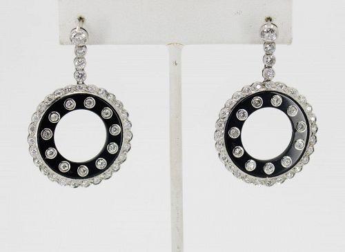 Diamond, black onyx dangle earrings in platinum