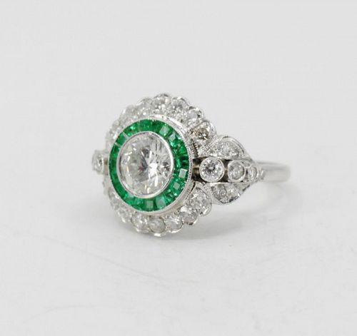Diamond, Emerald engagement ring set in platinum