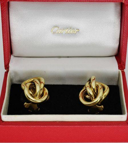 Cartier love knot earrings in 18k yellow gold in original box.