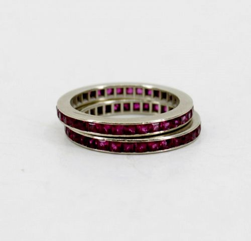 Pair of ruby eternity bands rings in 14k white gold