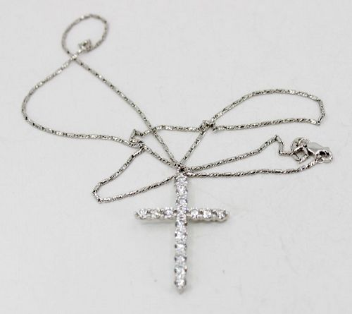 Diamond cross pendant in 18k gold with 14k gold chain necklace