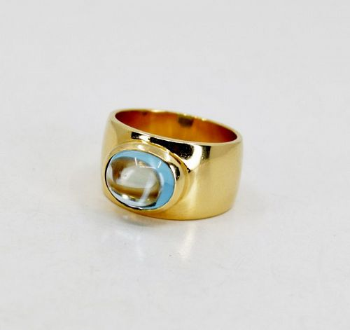Designer signed aquamarine band ring in 18k yellow gold