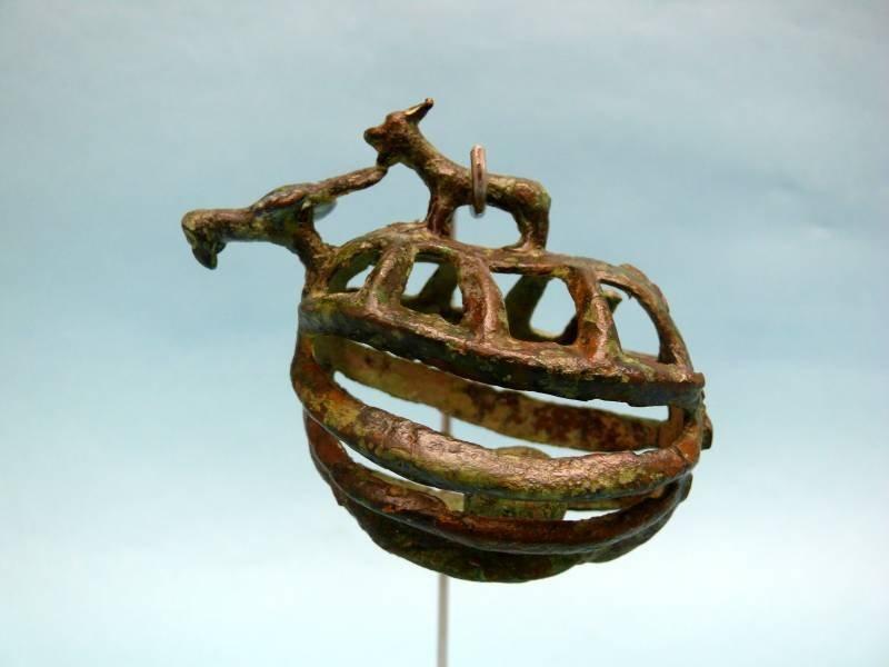 Set of Eight Luristan Bronze Zoomorphic Bells