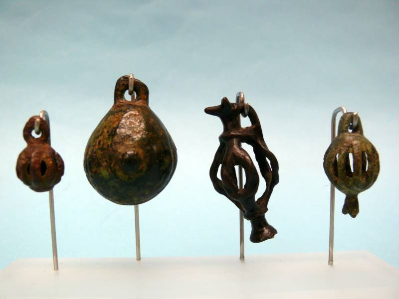 Set of Eight Luristan Bronze Zoomorphic Bells