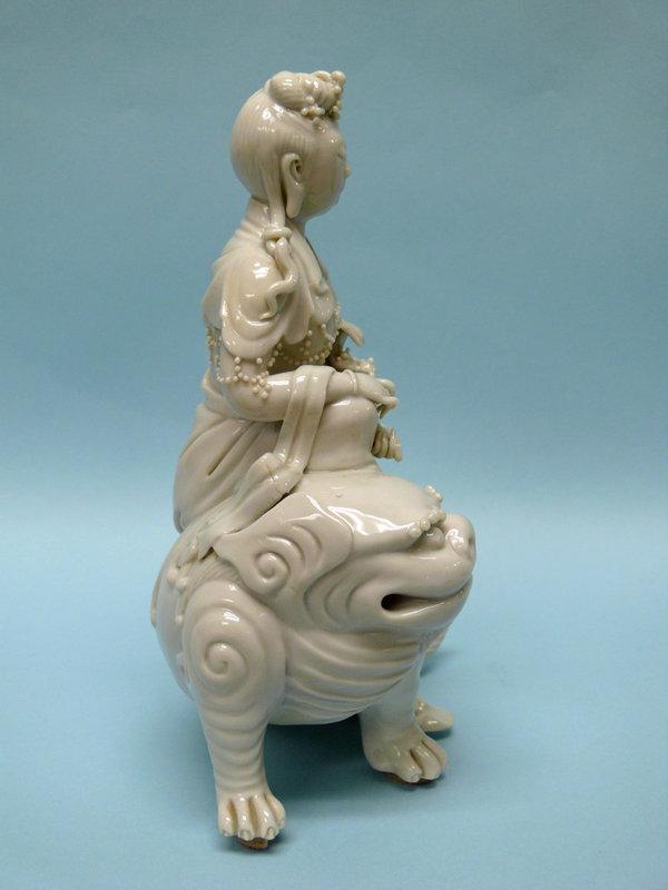 Qing Dynasty Blanc de Chine Porcelain Guan Yin riding Dragon