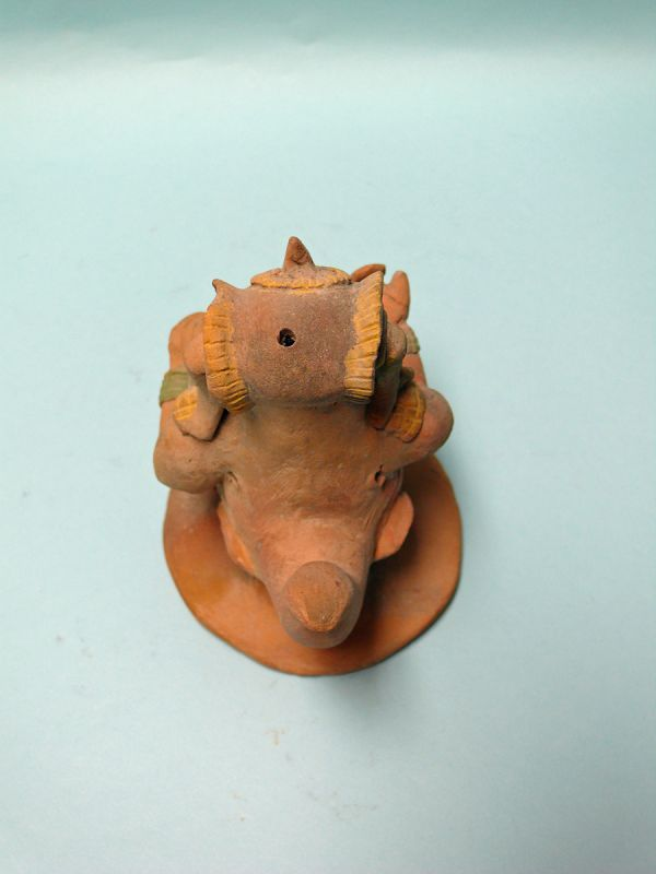 Jama Coaque Terracotta  Seated Shaman with Horn, Tail