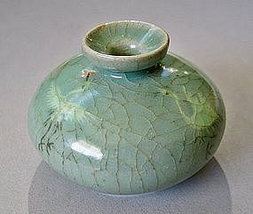 A Very Fine Sea-Green Koryo Celadon Inlaid Oil Bottle
