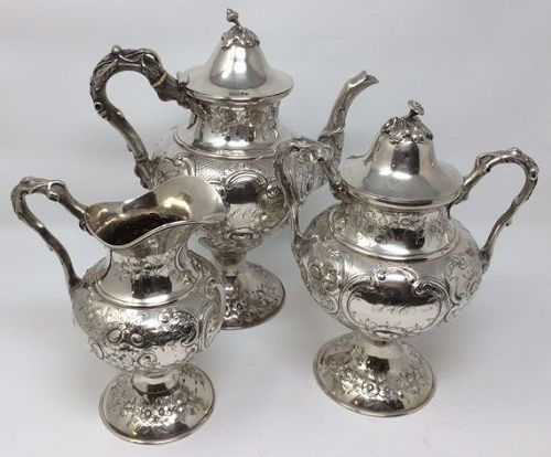 H L Webster Coin Silver Tea Set, Teapot, Creamer, Sugar Repousse
