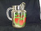 Glass Water pitcher featuring red apples