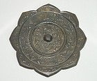 Tang dynasty bronze mirror with animal and flower motif