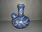 Rare Ming dynasty blue glaze and white slip kendi