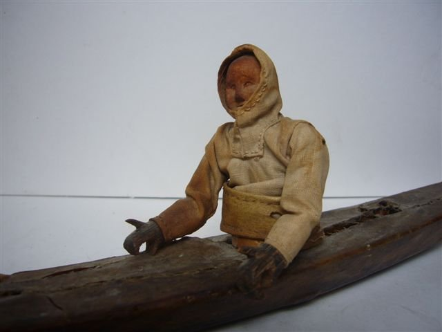 Eskimo Canoo with Peddling Figure