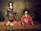 Isho Ningyo of Two Geisha Singing and Playing Music