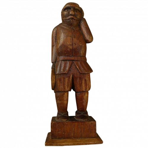 Folk art hand-carved wood statuette of a man