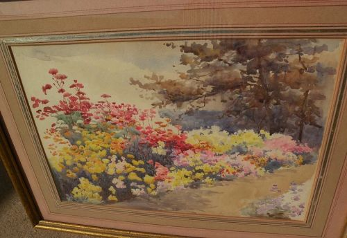 Impressionist watercolor painting of a colorful flowering garden