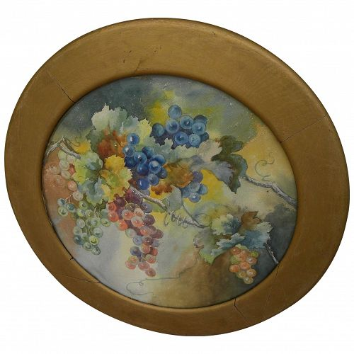 Vintage circular watercolor painting of grapes hanging on the vine