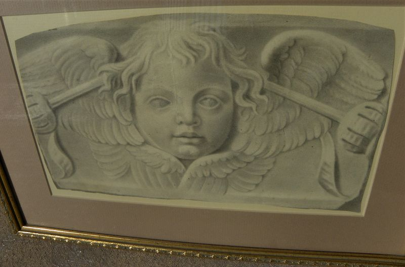 Antique or old master charcoal drawing of putto