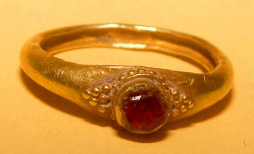 Ancient Gold Ring with a Dark Red Ruby