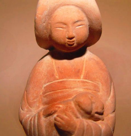 Rare Seated Tang Lady Cradling a Dog - 618 - 907 AD