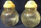 "Vertical Rib Shaker Pair Crystal with Cream Lids 4"" Hazel Atlas Glass"