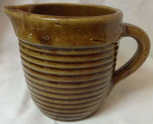 """Pitcher 4.75"""" Brown U S A Pottery"""
