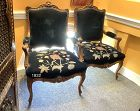 Pair of French Louis XVI Fauteuil chairs in carved walnut