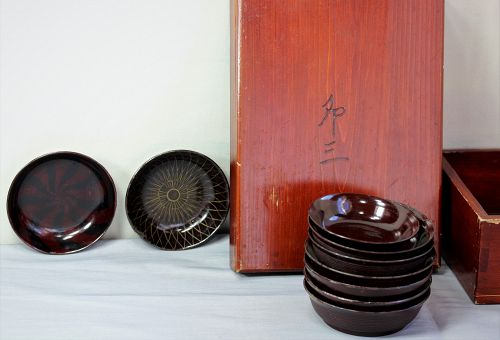 Nine(9) Japanese brown Lacquer on wood saki dishes in wooden box