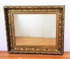 Gold framed large Mirror, deep carved on wood