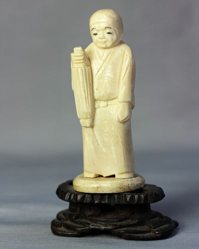 Japanese carved Bone Okimono, figure on wooden stand