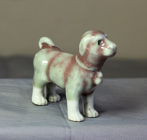 Chinese Porcelain Sang de boeuf Dog Figure, Iron Red Glaze