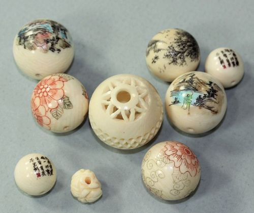 Nine(9) painted and calligraphy written beads