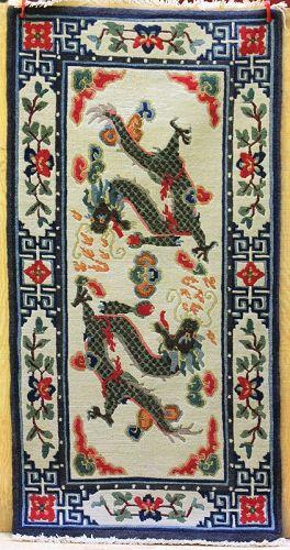 Tibetan hand woven Wool Rug, chasing Dragons