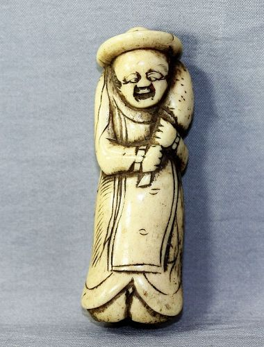 Japanese Dutchman Netsuke, carved out of Stag Antler