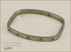 STAINLESS STEEL AND 18K HINGED BANGLE BRACELET