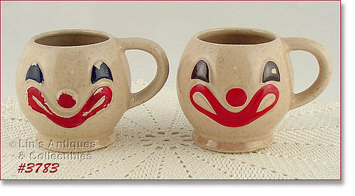 McCOY POTTERY � PAIR OF VINTAGE CLOWN FACE MUGS / CUPS