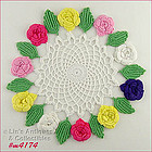 CROCHET DOILY WITH DIFFERENT COLOR FLOWERS