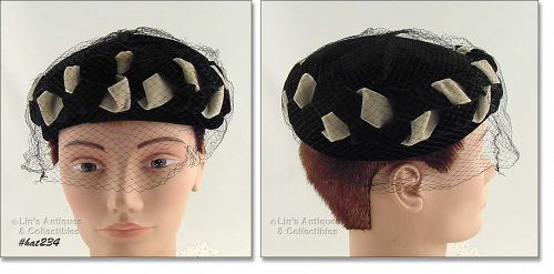 BLACK AND BEIGE HAT WITH BLACK NETTING VEIL