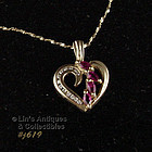 RUBY AND DIAMOND 14KT YELLOW GOLD HEART PENDANT ON 14KT YG CHAIN