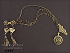 DOUBLE PIN WITH �TASSELS� AND A LOCKET