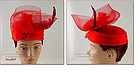 BEAUTIFUL RED HAT WITH NETTING AND FEATHERS