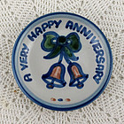A VERY HAPPY ANNIVERSARY PLATE BY M.A. HADLEY LOUISVILLE STONEWARE