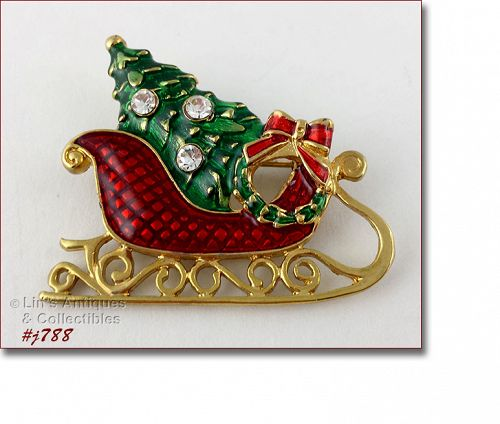 EISENBERG ICE SLEIGH SHAPED PIN FILLED WITH A TREE AND WREATH
