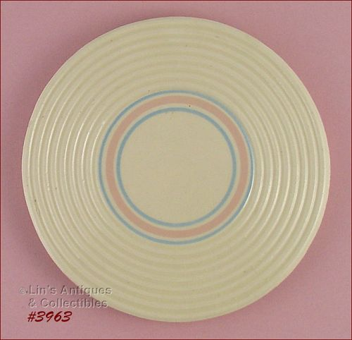 McCOY POTTERY � PINK AND BLUE STONECRAFT TRIVET
