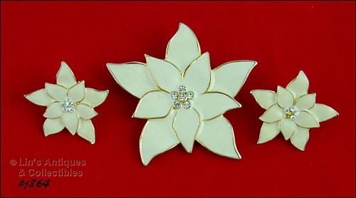 EISENBERG ICE IVORY COLOR POINSETTIA AND MATCHING CLIP EARRINGS