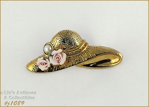 UNMARKED 1928 HAT SHAPED PIN GOLD TONE WITH PINK ROSE