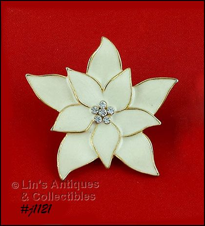 EISENBERG ICE IVORY COLOR POINSETTIA PIN WITH CLEAR RHINESTONES CENTER