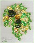 Signed Eisenberg Rhinestone Brooch Shades of Green and Yellow